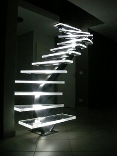 LED lighted Acrylic Stairs. To walk down. In a curvy pattern. With no rails. In the dark.