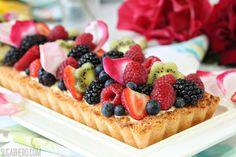 a coconut macaroon tart dough (just egg whites, sugar and coconut) filled with a passionfruit white chocolate ganache that is folded in fresh whipped cream; topped with fresh fruit