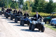 Grooms entrance using four wheelers! Country wedding ideas