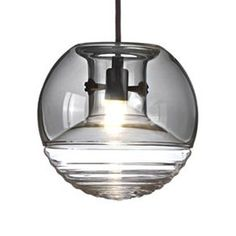 Spheres of light it is with the Flask Pendant by Tom Dixon, 18 centimeters of glowing glass in two sections: ridged base for rippling effect, smoked hood to cut glare. Glass Pendant Shades, Glass Pendant Light, Glass Pendants, Pendant Lighting, Tom Dixon Lampe, Powder Room Lighting, Tom Dixon Lighting, Contemporary Pendant Lights, Hand Blown Glass