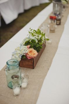 White tables clothes on long rectangular tables, with burlap runner. Exactly what I want to do.
