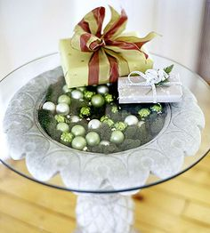 Holiday Decor that Lasts from Thanksgiving to Christmas: Bathing Beauty- Transform a concrete birdbath into a beautiful side table by lining the basin with moss, sprinkling in matte-finish ornaments for Christmas (or pinecones for Thanksgiving), and topping with glass.