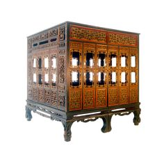 A canopied, carved bed made in the Straits Chinese style. This furniture is a fusion of Chinese Xing dynasty ornateness and early 19th century English dignity and decorum, all adapted to tropical climate. This bed is made of nam wood, a Chinese variety of cedar. Of unusually ample proportions and with doors and finished surfaces on all four sides, it was no doubt commissioned by a wealthy and important family.