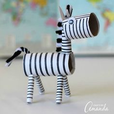 I have made lots and lots of cardboard tube crafts in my day! While I haven't done it yet, I could certainly put together a list of cardboard tube animals from A to Z, so why not be backwards and start my list with a zebra? Cardboard Tube Crafts, Paper Towel Roll Crafts, Cardboard Paper, Toilet Paper Crafts, Cardboard Playhouse, Cardboard Furniture, Recycled Furniture, Handmade Furniture, Cute Kids Crafts