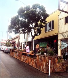 Judah Street Parklet (hosted by Trouble Coffee) in San Francisco, just one of their Pavement to Parks projects.  Tiny urban parks, or parklets, occupy space that used to be reserved for cars. These miniature oases outside of coffee shops & cafes are perfect places for coffee & a break from the usual bustle of the street. The movement began in 2005 when design studio Rebar installed a single parking space-sized park in a metered spot for two hours.  #America