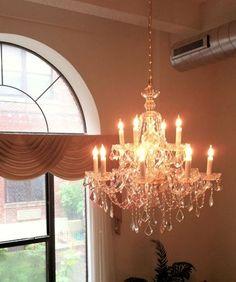 12 arm Brilliance chandelier in entrance - from Designer Chandelier