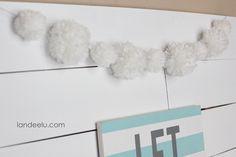 DIY Snowball Yarn Pom Pom Garland  | landeelu.com   Make cute yarn pom poms with just your hands!  No special tools required.