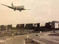 70 YEARS OF THE LUFTBRÜCKE 1948 - 2018 An American Douglas C-124 Globemaster II, a massive-size cargo airplane, moments before landing at Flughafen Tempelhof.  [Photo: Harrington, D. Pioniere der Luftbrücke. Nishen Kommunikation, Berlin 1998].