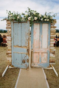 This wedding aisle backdrop is perfect for a fairy tale wedding. The doors open onto the unknown and give a very dreamy look to the whole affair.
