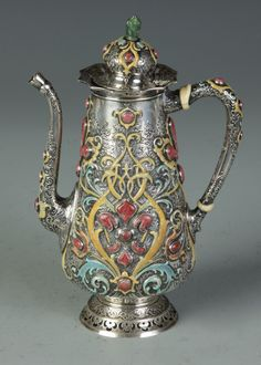 "Fine & Rare Tiffany & Co. Silver Enameled & Hardstone Chocolate Pot of Moorish Design, C. 1875-1891. Designed by Edward C. Moore. Hand chased, acid etched relief work, bezel set malachite, jade finial. Exhibited at World's Columbian Exposition, Chicago, 1893. Sgn. & numbered on underside, 10156 & 3437. 16.95 Troy oz. Some wear to enamel. Wadsworth Family, Geneseo, NY. Ht. 8 1/2"" Est. $6,000-$10,000"