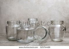 empty glass bottle and jars over wood