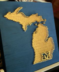 Etsy made to order, hand painted, nailed, and strung tribute to Michigan on a wooden board.