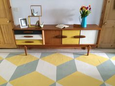 Upcycled 1960s retro teak painted sideboard on painted geometric floor. Farrow and Ball floor paint