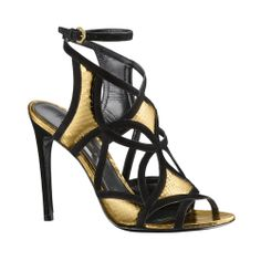 Sandalias doradas con ribete negro, de Louis Vuitton.