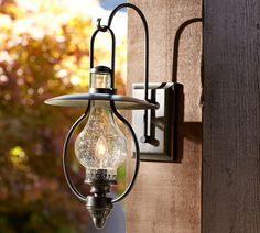 Barnwood, Wood Beams and Kerosene lamps belong together...love these!