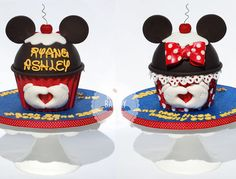 A double sided giant cupcake for Ryan & Ashley's 5th wedding anniversary. They love everything Disney, and asked for a special message from Disneyland to be written on the board... 'and they lived happily ever after,' along with the date of their wedding. From the right angle, the hands have a heart shape in the middle.  The bottom of the cake was made with candy melts in the Wilton giant cupcake mold, the top was baked in half of the Wilton ball pan.