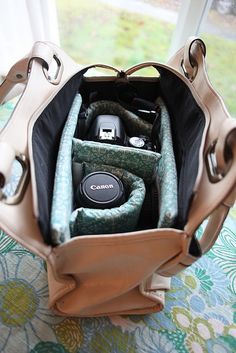 DIY Camera Bag Insert for less than $20 by Vanilla & Lace - designed to hold a DSLR and one lens and insert into a purse you already own. I'm sure you could adapt the instructions to accomodate a larger purse and additional photography accessories.