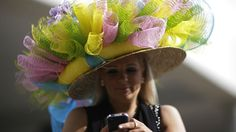 Ashley Cebak of Chicago looks at her phone before the running of the Kentucky Derby horse race at Churchill Downs Saturday, May in Louisville, Ky. Derby Horse Race, Kentucky Derby Race, Ribbon In The Sky, Funky Hats, Run For The Roses, Funky Dresses, Churchill Downs, Derby Day, Royal Ascot