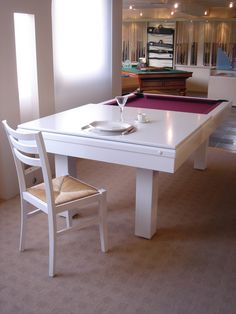 What a fantastic idea! Have your dining table multi-task as a games table, billiard table, ping pong table perhaps?