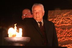 Holocaust survivor Chaim Grosbein lights one of the six torches at the opening ceremony marking Holocaust Martyr's and Heroes' Remembrance Day 04/05/2016