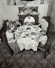 """Babcock family  dinner with generous amounts of meatloaf and gravy, steamed potatoes, peas and carrots, sliced tomatoes, celery and olives, sliced bread """"and"""" rolls with fresh butter.   Rochester, N.Y., March, 1943"""