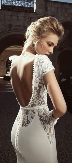 I really love the open back of this form fitted dress....gorg