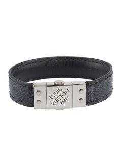 This Louis Vuitton bracelet shows scuffing to the hardware. It features a push lock closure. Weight: 30g Color: Black Exterior Condition: Gently Used Interior Condition: Gently Used Material: Canvas O