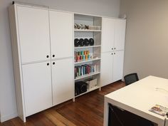 Lundia Adjustable shelving with inset doors and painted white.