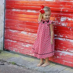 Smocked Minnie Bishop Dress from Smocked Auctions. Red and white polka dot.