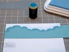 Line up your cloud border die on your paper, and start sponging. VERY important tip - sponge up and down, not in circles or in lines.... This will make a big difference in your inking