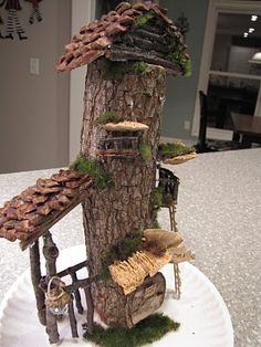 Oooo  Look! A Fairy High Rise...too cute and I LOVE the roof is shingled with pinecone scales...cute!