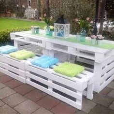 Clever pallet projects!  DIY pallet picnic table and benches.  Love things that are made out of old pallet wood and this picnic table and benches are just gorgeous.  Love that they painted it white - it looks so pretty! #palletprojects #houseideas #diyprojects #palletfurniture #diyhomedecor #outdoorpatioideas #patioideas #patioideasonabudget #springdecor #gardenideas #woodprojects #upcycling