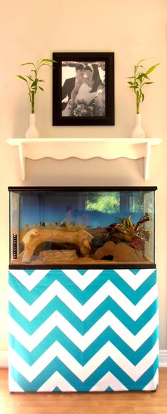 Tim Roth's, yes that is my snakes name, new tank skirt.  I was very excited to have my fabic arrive that I wasted no time and had this made within an hour.  Such a quick easy way to make your pets enclosure part of the room.