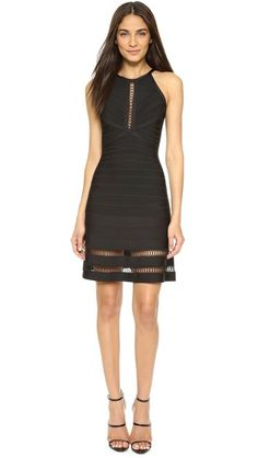 Crocheted insets add delicate detail to this fit-and-flare Herve Leger mini dress. Sleeveless. Hidden back zip. Unlined.