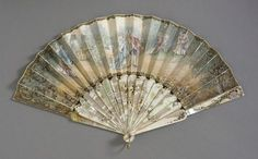 fawnvelveteen:~1910, France - Folding Fan - Paper leaf, mother-of-pearl sticks, brass metallic loop and rivet~