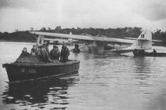 Crew of Consolidated Catalina XJ202 coming ashore in 1945.Lough Erne,Co Fermanagh,Northern Ireland.Bases on Lough at Castle Archdale,Killedeas, & landplane bases RAF/RCAF/US around Lough too,in particular the small surviving GA field at Saint Angelo,south of Enniskillen today.Patrolled the Atlantic Gap,with Irish Republic turning blind eye to them flying over Donegal,despite neutrality.