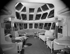 """1948 publicity photo of a Chicago, Milwaukee, St. Paul & Pacific Railroad """"Skytop"""" lounge car. The Milwaukee's streamlined Hiawatha passenger trains featured a variety of distinctive observation cars. The fourth and final design was the Skytop Lounge, styled by industrial designer Brooks Stevens and produced by the Milwaukee Shops in 1948. The cars' round ends were 90% glass and included 24 revolving chairs, plus a drawing room."""