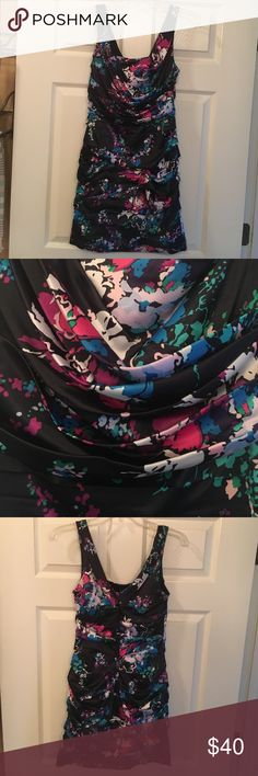 Express dress This navy floral dress is perfect for spring and summer events! It is very classy! The floral colors allow for many different color accessories and shoes! It is beautiful! It has been worn two times and is in great condition! Express Dresses