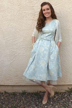 pale blue dress, beige heels, white cardigan, tule underskirt.