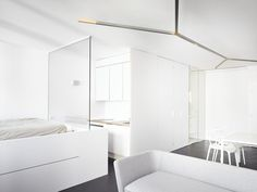 Small Flat In Geneva Designed With A White-Based Color Scheme