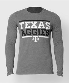 """This fitted triblend heather grey longsleeve shirt reads """"Texas Aggies"""" in black and white bold print with a block ATM centered at the bottom. Very soft, very tight and fitted. This Baseball Texas Aggies shirt is perfect for this upcoming season!"""