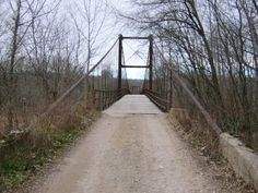 Grand Auglaize Swinging Bridge, Miller County, MO. Built in 1922, by Joseph Dice. As of 2011, average daily traffic=250, sufficiency rating: 9.0 (out of 100), appraisal rating: structurally deficient.