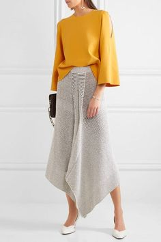 Stella McCartney's knitted top is cut to float away from the body. An effortless and flattering choice for the office and evening events alike, this marigold style has skin-baring cutouts at the shoulders and elegant fluted sleeves. Try yours with a midi skirt or flared jeans.