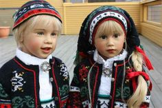 Ola & Paula, dolls by Sissel Skille, dressed in lovely knitted traditional Norwegian costumes.