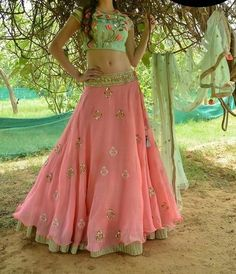 Pink and mint green Georgette Lehenga with embroidery on the choli. Lehenga has beautiful motifs all over. Choli has thread embroidery and Dupatta has delicate work all over. The fabric used is pure Georgette. Ghagra Choli, Sharara, Patiala Salwar, Lehenga Designs, Pink Lehenga, Bridal Lehenga, Floral Lehenga, Indian Attire, Indian Wear
