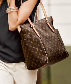 Totally GM.  What a great bag!  Comes in 3 sizes ~ GM, MM & PM.