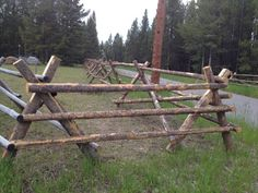 The posts of a jackleg fence are attached together in an X pattern and sit on the ground. The top rail rests in the joint of the X to stabilize the fence.