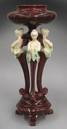 Antique Italian majolica urn with polychrome decoration, and supported by female winged figures. circa late 19th century