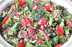 #broccoli #salad #organic  #healthy #taste #yum mayo free broccoli salad with honey yogurt dressing sprinkled with sunflower seeds & raisins.....Mmmmm here @ TML HQ