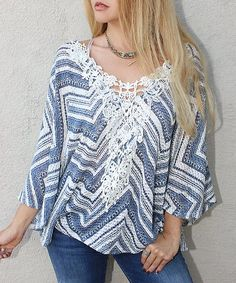 Amp up your boho-chic styles with this swingy tunic punctuated by a crochet detailing at the neckline.
